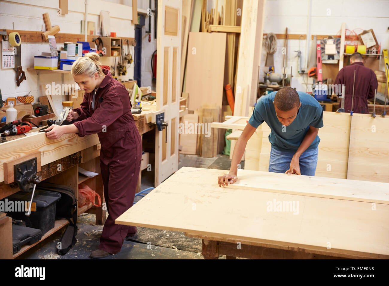 Staff Working In Busy Carpentry Workshop - Stock Image
