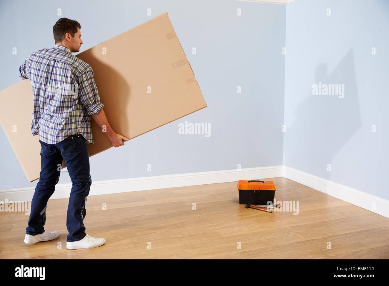 Man Preparing To Assemble Flat Pack Furniture - Stock Image