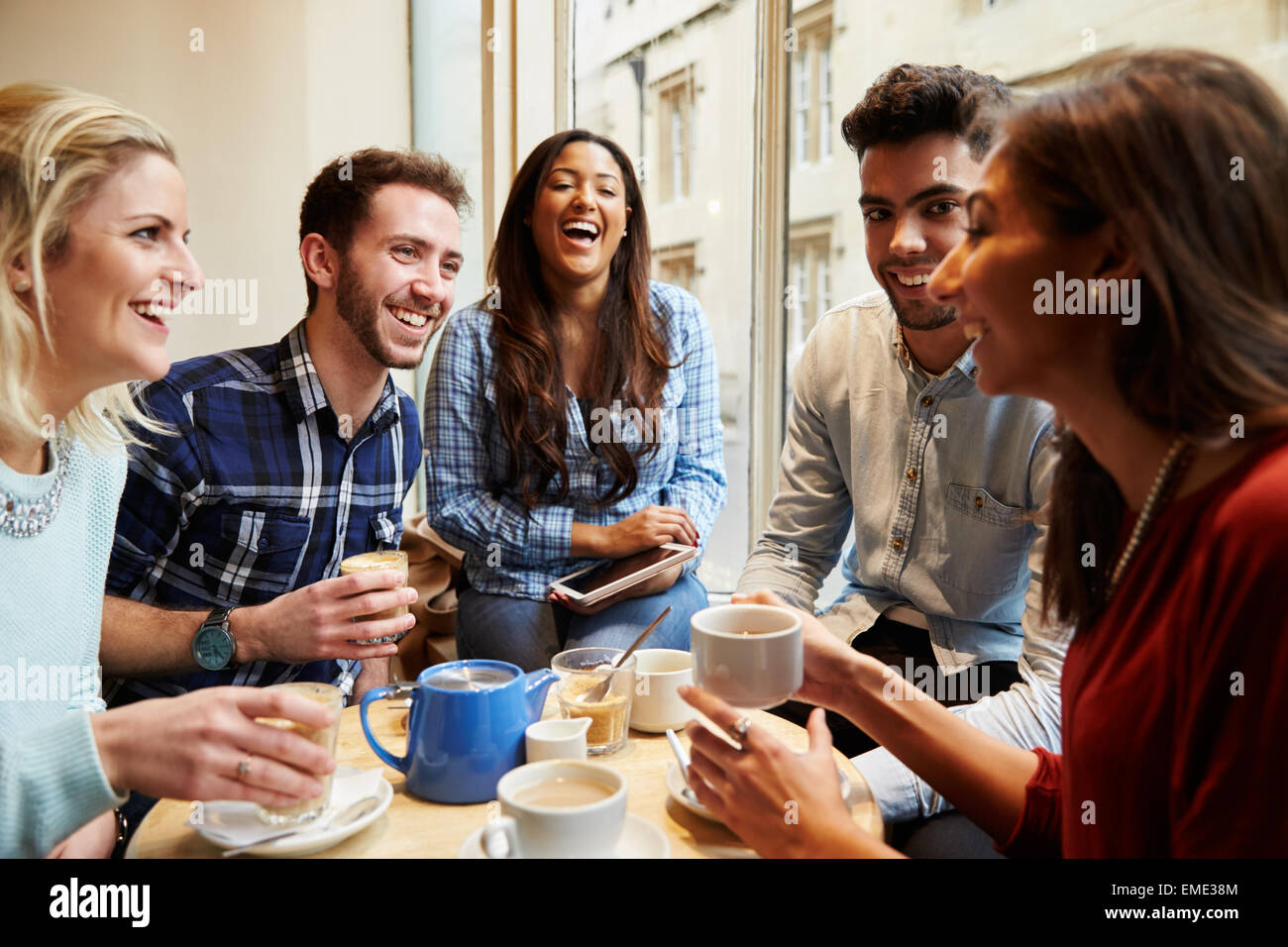 Group Of Friends In Caf' Using Digital Devices - Stock Image