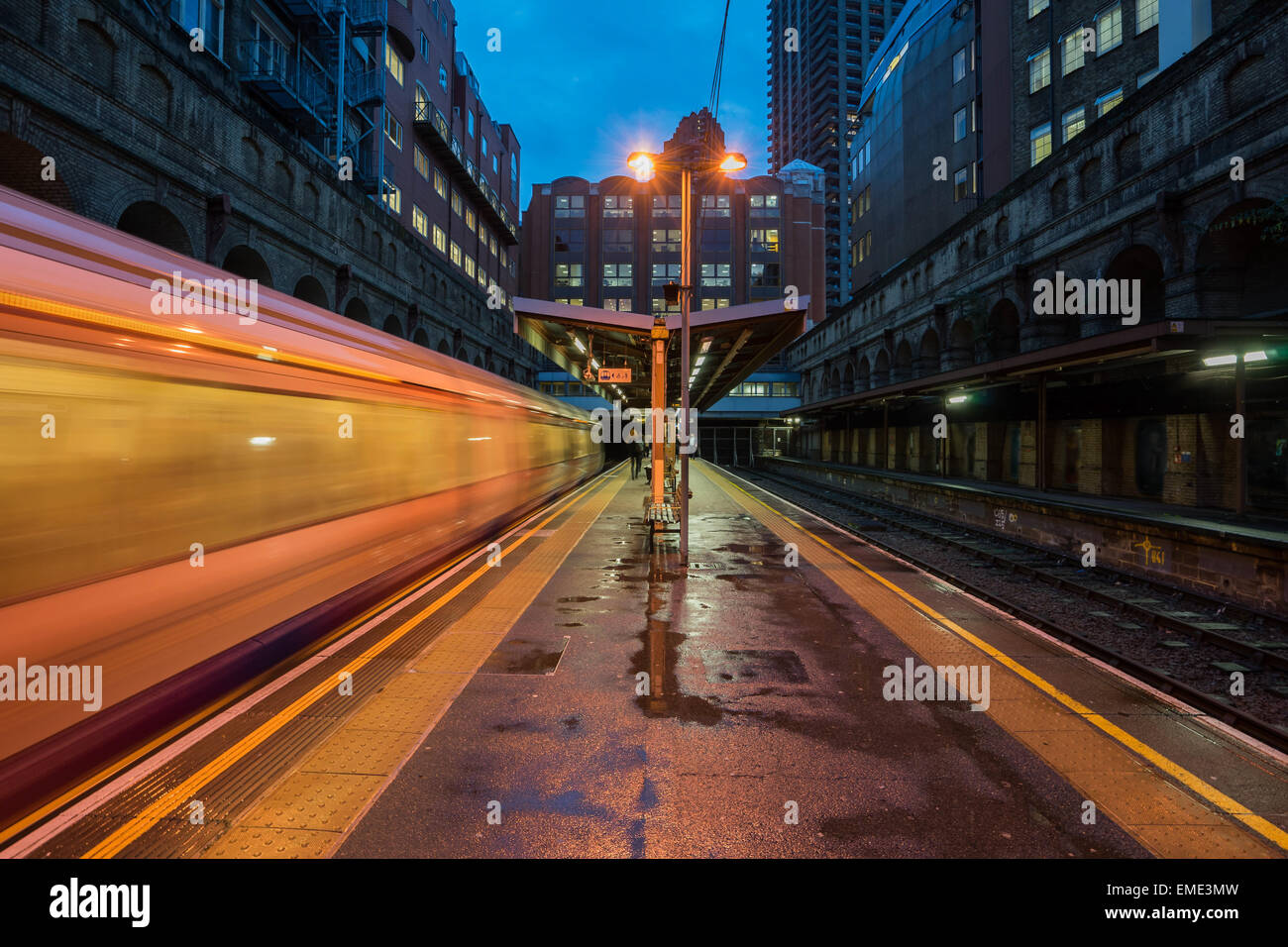Barbican station, captured late 2014 with a train leaving. - Stock Image