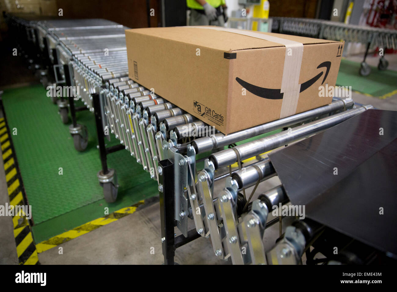 Amazon shipping center uses  advance tracking system to package orders and place into large tractor trailers for - Stock Image
