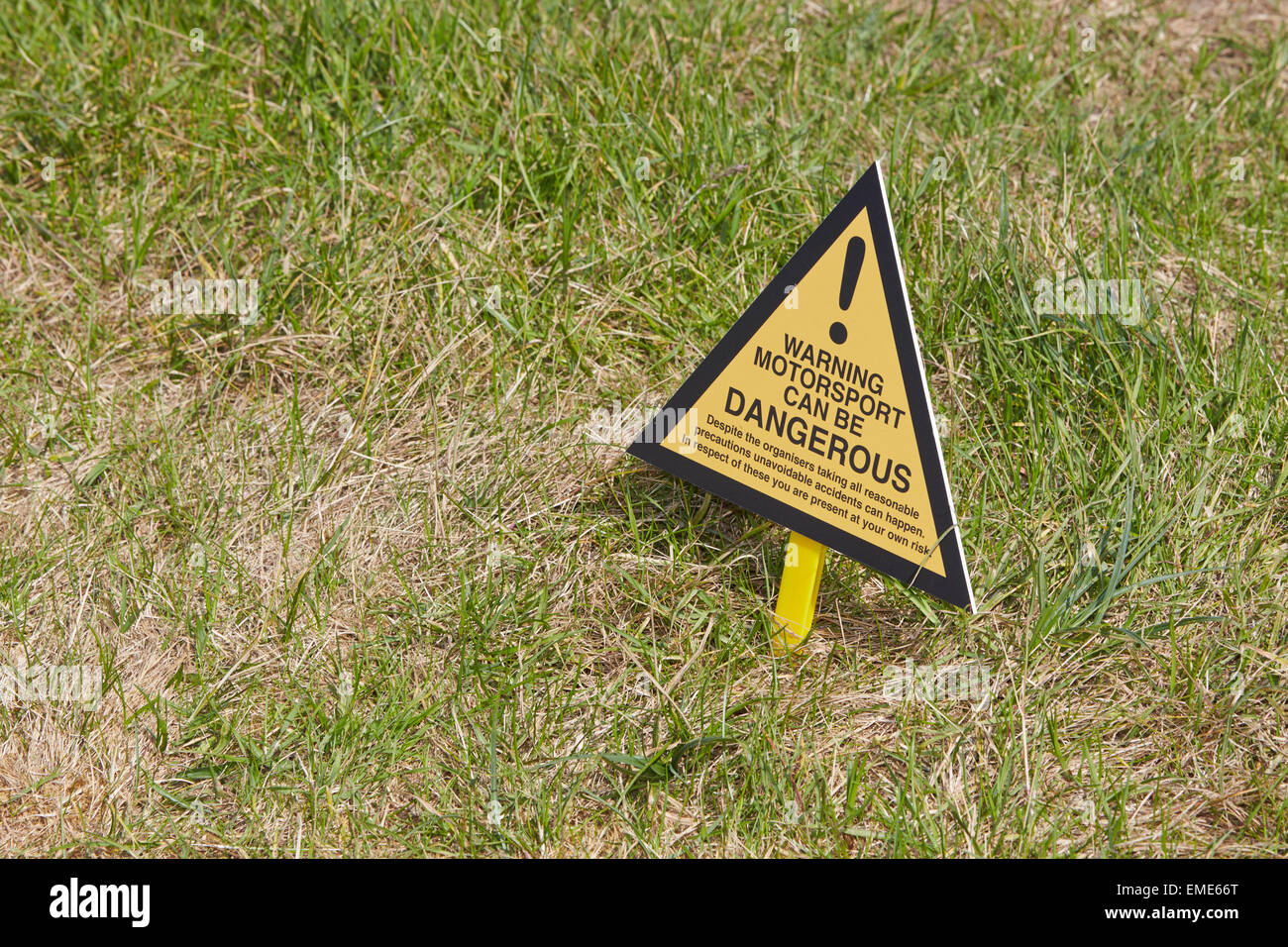 Sign reading Warning Motorsport ican be Dangerous at the Santa Pod Raceway - Stock Image