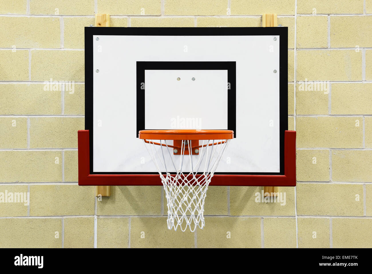 Close up of an indoor wall mounted basketball hoop - Stock Image