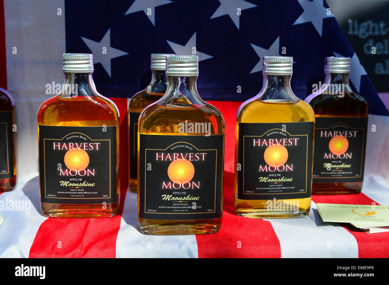 Bottles of Harvest Moon apple moonshine spirit drink on sale, Craft Village, Londonderry (Derry), Northern Ireland - Stock Image