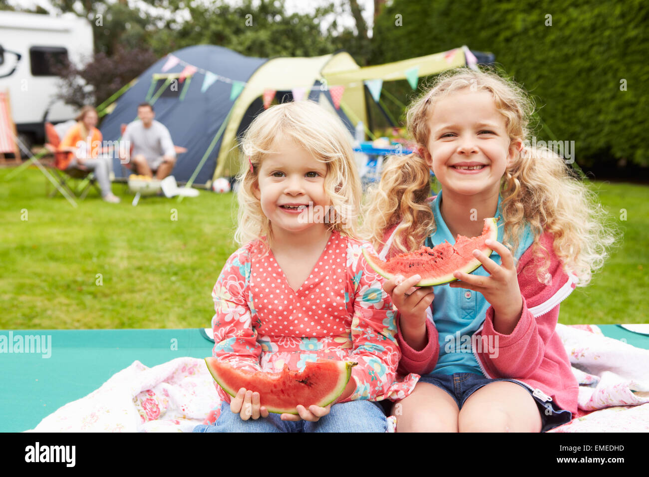 Children Enjoying Picnic Whilst On Family Camping Holiday - Stock Image