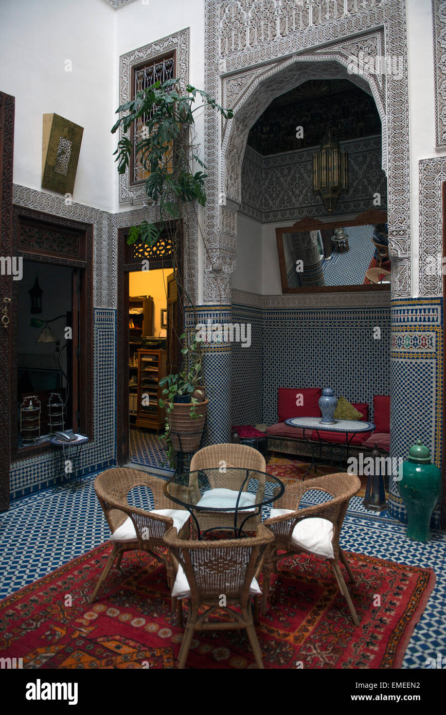 Fes, Morocco. Riad Dar Cordoba.  Restored riad features tile mosaics and plaster carvings. - Stock Image