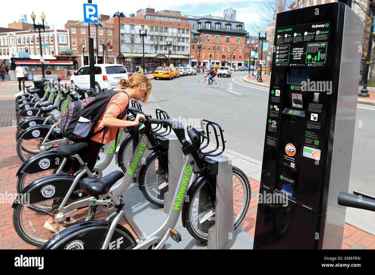 Cambridge city bike station. Boston Hubway bicycle available for tourists and Harvard students. - Stock Image