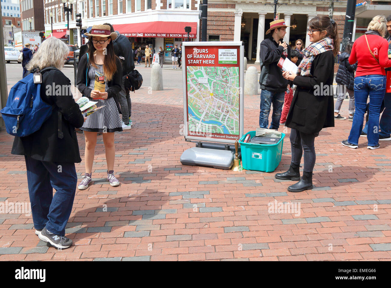 Harvard University tourists meet with tour guides in Cambridge, Massachusetts, USA. - Stock Image