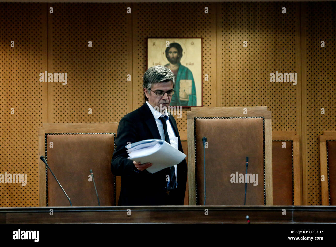 Athens, Greece. 20th Apr, 2015. A court clerk is seen in the courtroom at the opening of the trial of 69 members - Stock Image