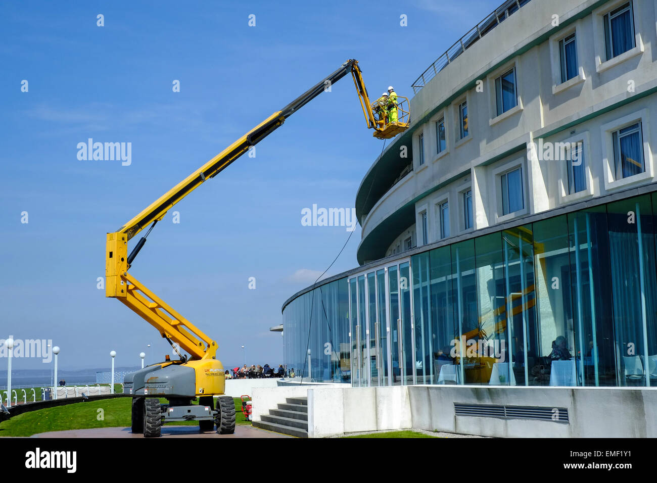 A specialist cleaning company power-washing the outside of The Midland Hotel in Morecambe, Lancashire - Stock Image
