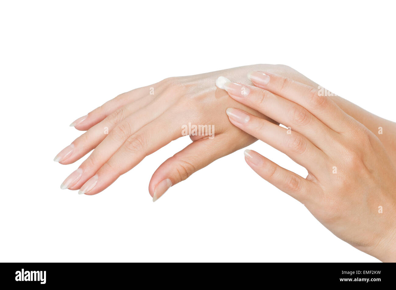 Two woman hands with moisturizer body cream isolated on white - Stock Image