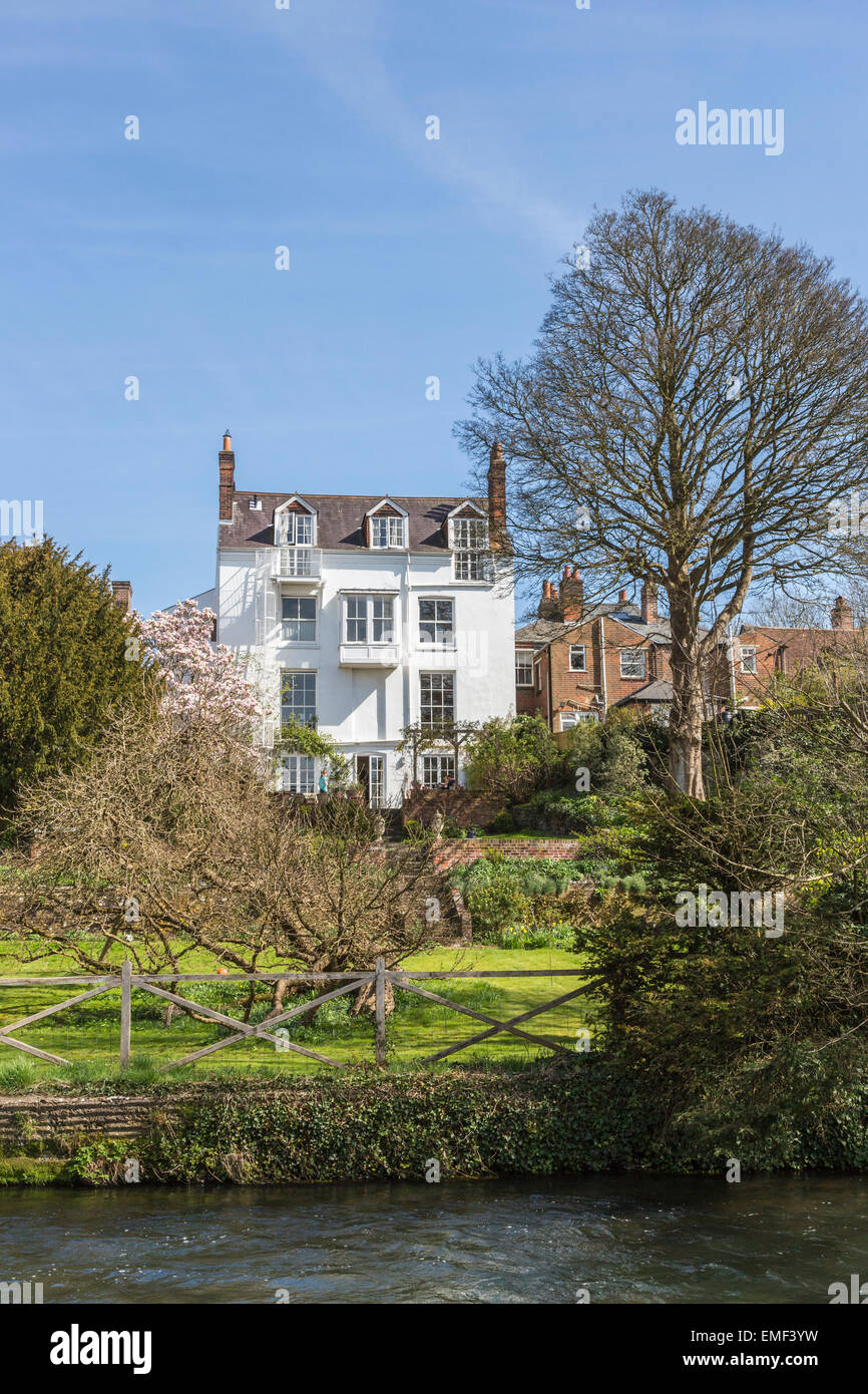 British prime residential real estate: Lovely large, imposing white town house property on the River Itchen, Winchester, Stock Photo