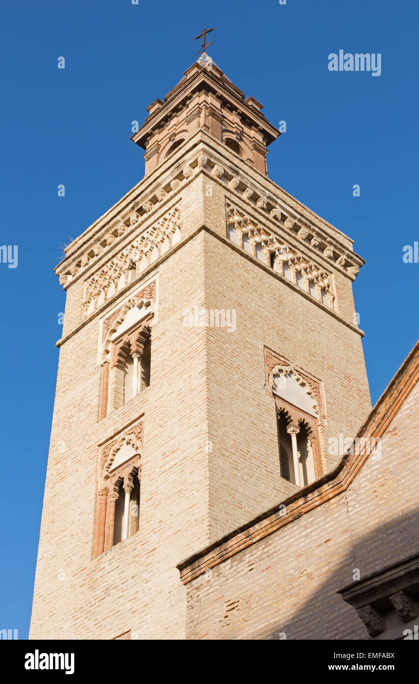 Seville - The tower of San Marcos church in the mudejar style. - Stock Image