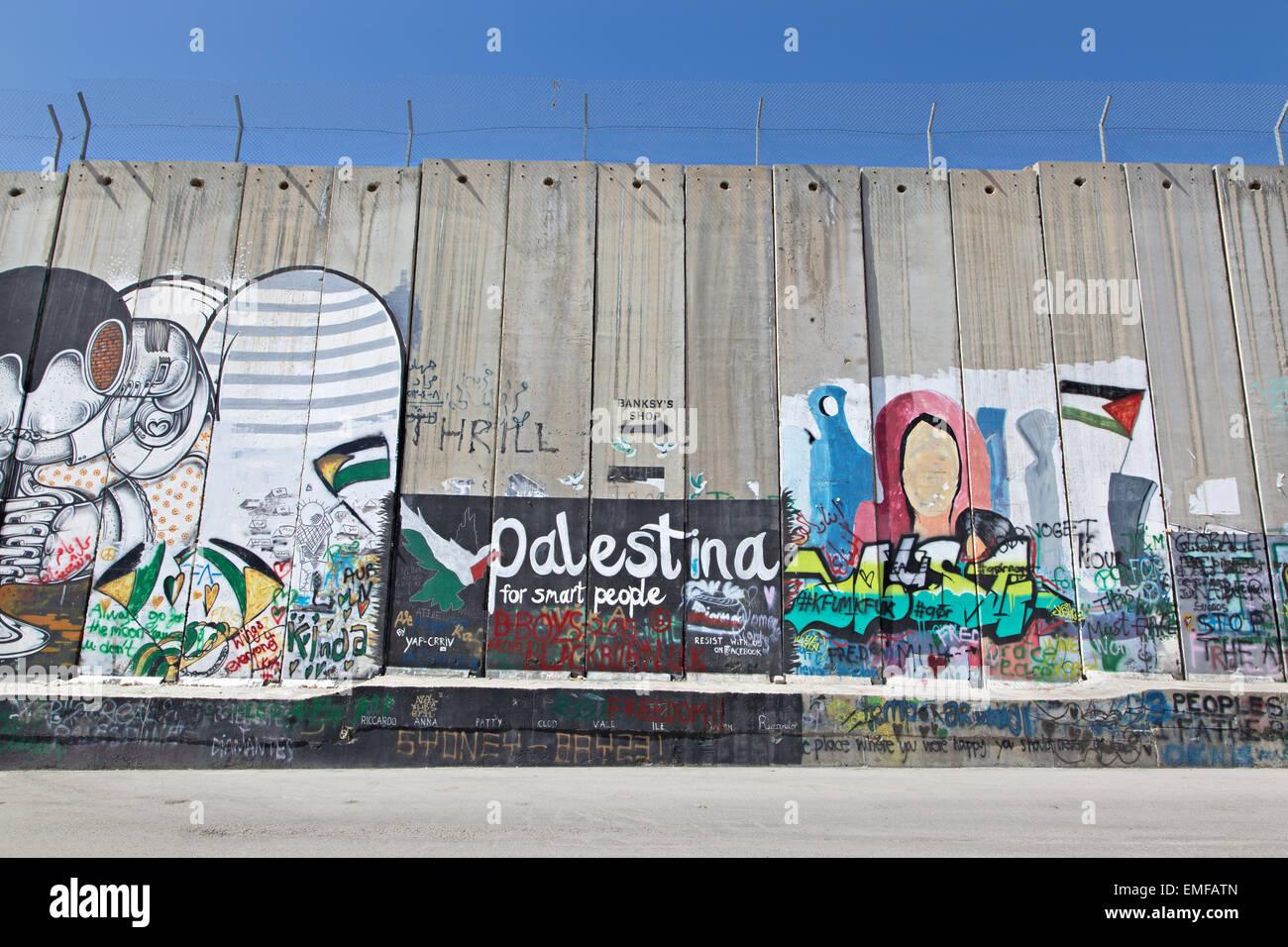 BETHLEHEM, ISRAEL - MARCH 6, 2015: The graffitti on the Separation barrier - Stock Image