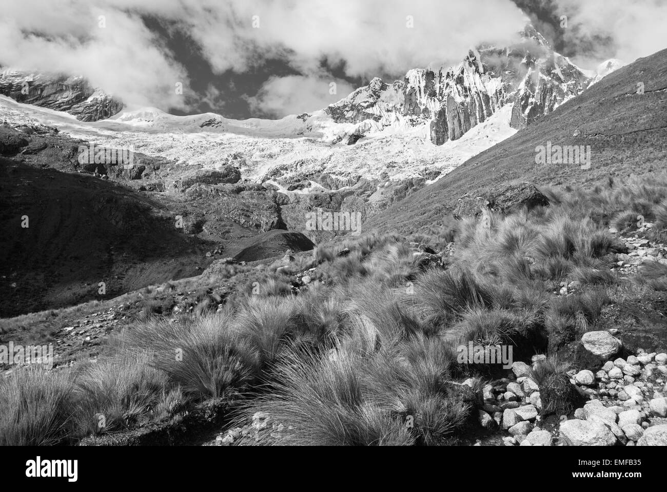 Peru - Tawllirahu peak (hispanicized spelling Taulliraju - 5,830) in Cordillera Blanca in the Andes from the trek - Stock Image