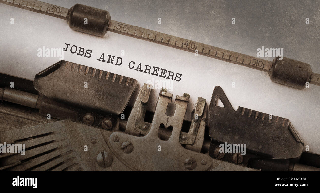 Vintage typewriter, old rusty and used, jobs and careers - Stock Image