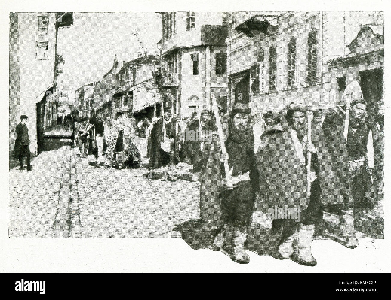 This photo from World War I shows Serbian volunteers who had no rifles. They were mostly old men, and were employed - Stock Image