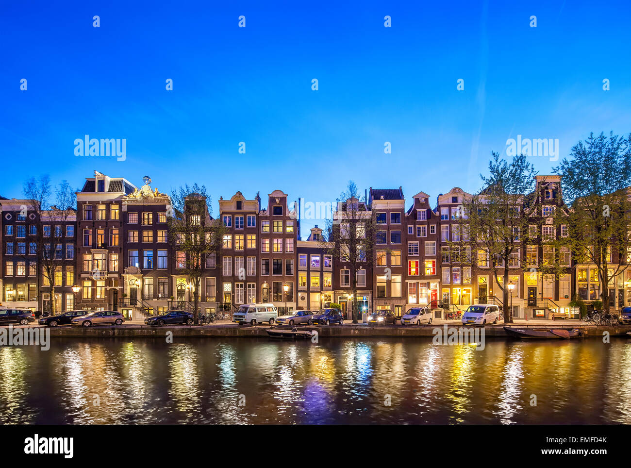 Historic Houses Amsterdam Singel 396 - 366 at night. Amsterdam Canal houses romantic scenic view at sunset. - Stock Image