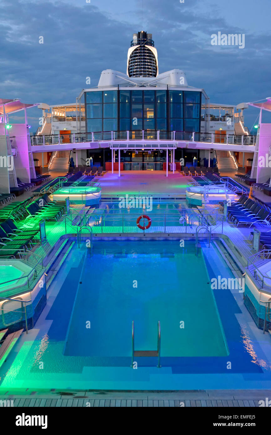 Flood lighting on cruise ship pool deck at end of day with passengers below decks for evening meal (for daytime - Stock Image