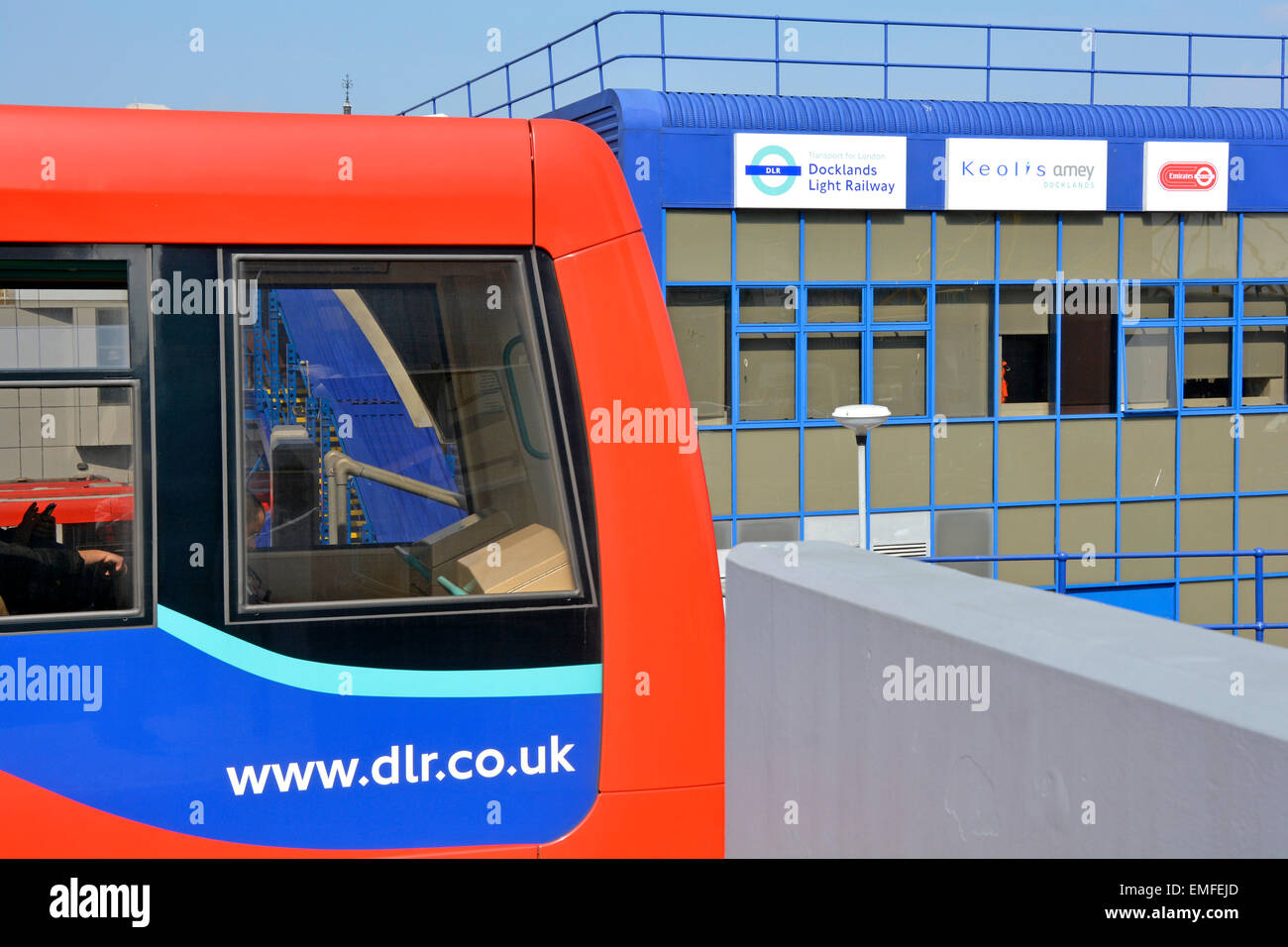 DLR train & Keolis Amey partnership sign board on the Poplar depot now operating & maintaining Docklands - Stock Image