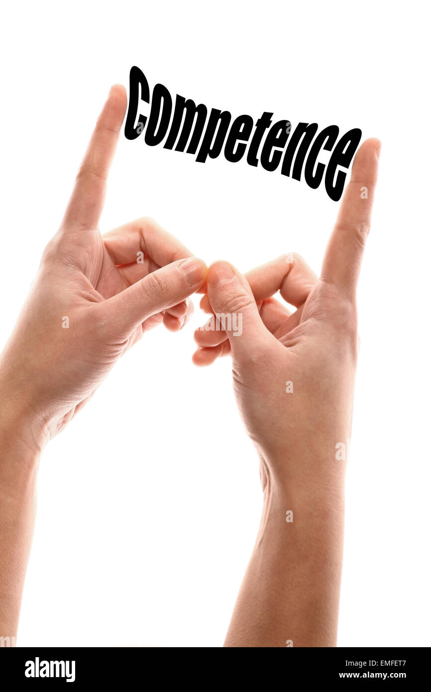 Color vertical shot of two hands squeezing the word 'competence'. - Stock Image