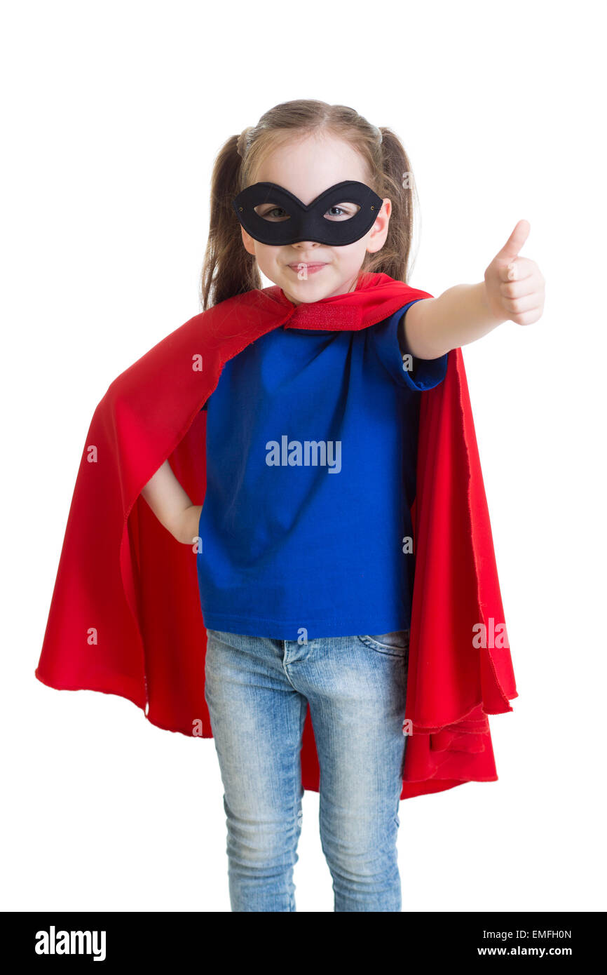 Child shows thumb up pretending to be a superhero - Stock Image