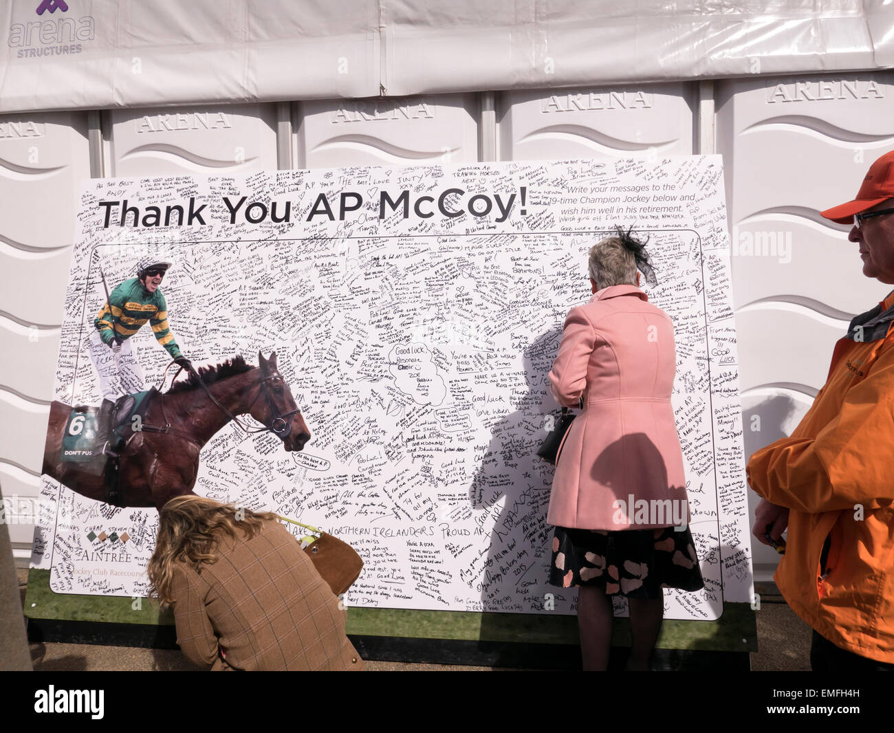 Signing the congratulations board for AP McCoy, Crabbies Grand National 2015. Aintree, Liverpool, Merseyside, England, - Stock Image