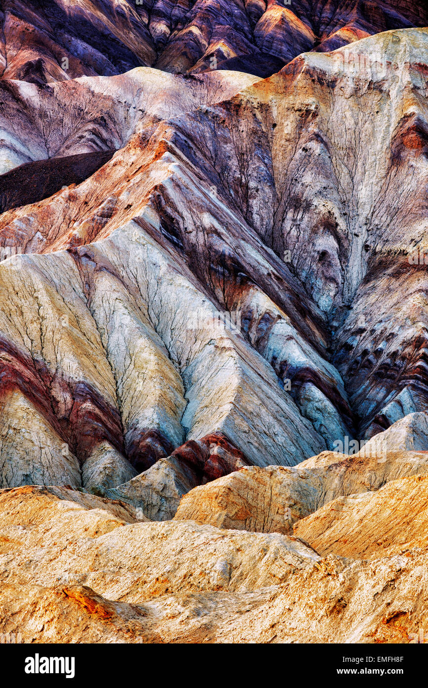 Civil twilight enriches the multi colors of Golden Canyon Badlands in California's Death Valley National Park. - Stock Image