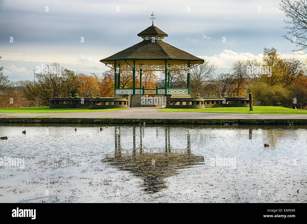 Bandstand and pond in Huddersfield, England. - Stock Image