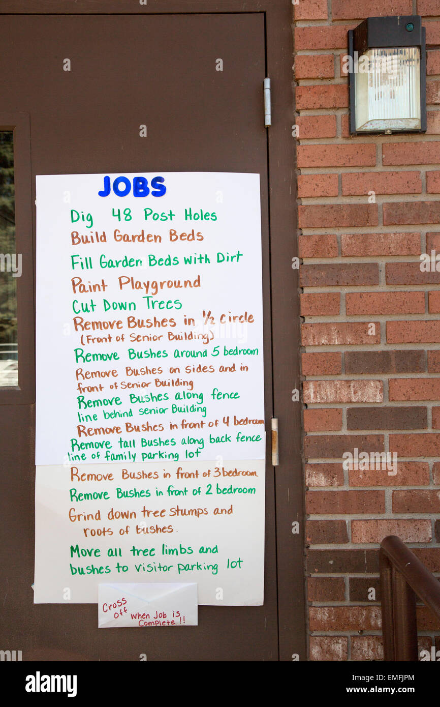 Rockford, Michigan - A list of jobs for volunteers working at a senior citizens housing complex. - Stock Image