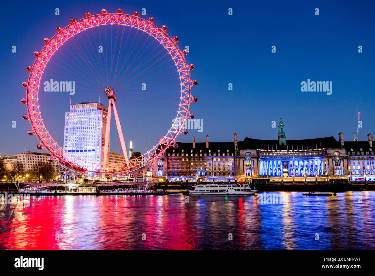 The London Eye and River Thames with Trees At Night London UK - Stock Image