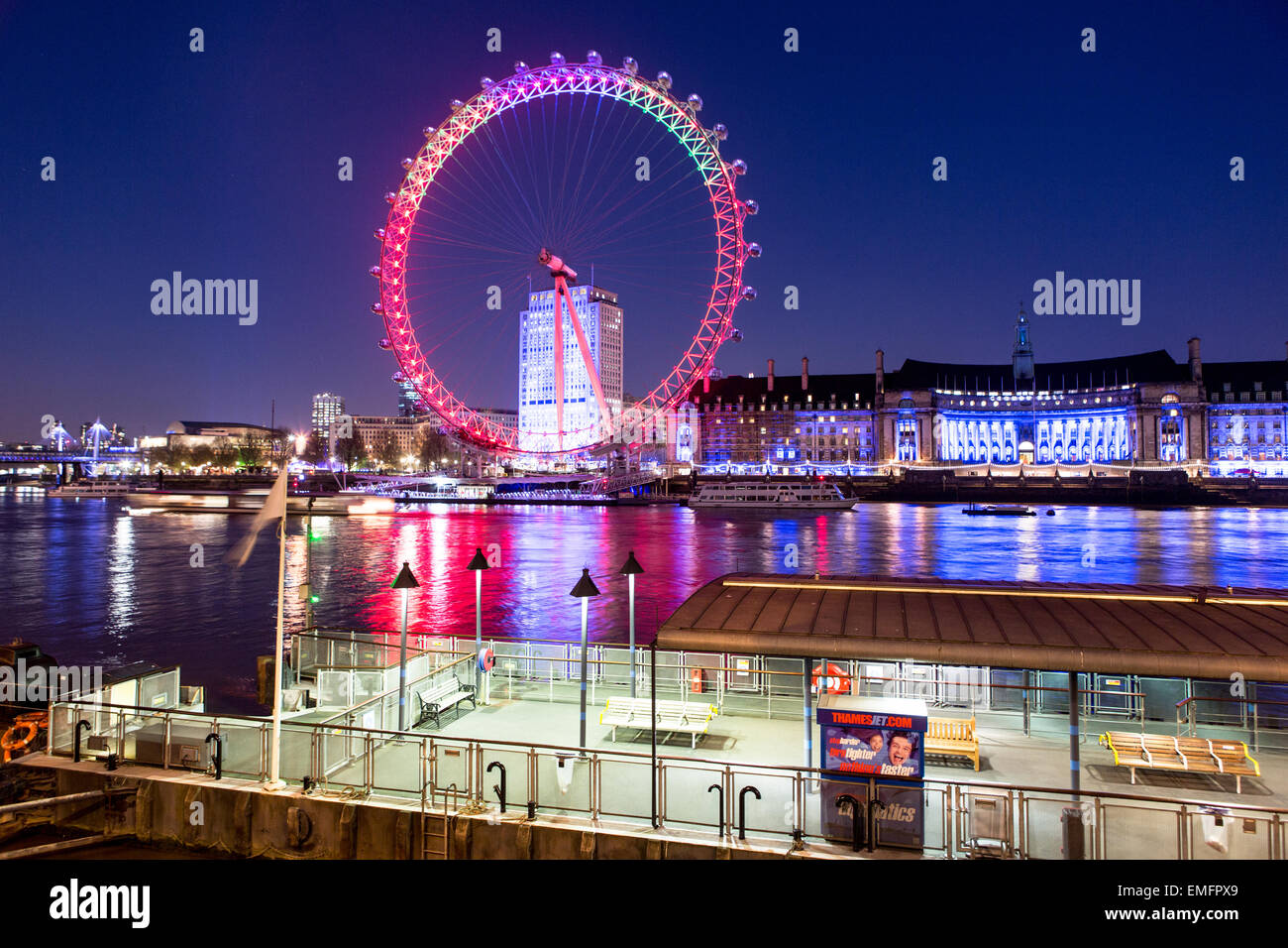 The London Eye and River Thames At Night London UK - Stock Image