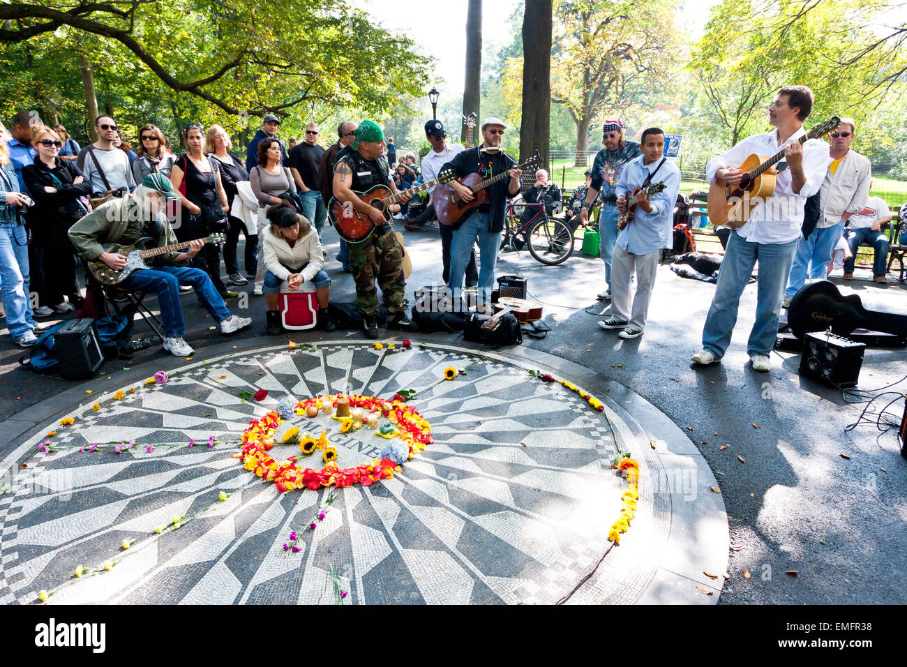 Fans gather around the Imagine memorial on John Lennon's birthday, Strawberry Fields, Central Park, New York, - Stock Image