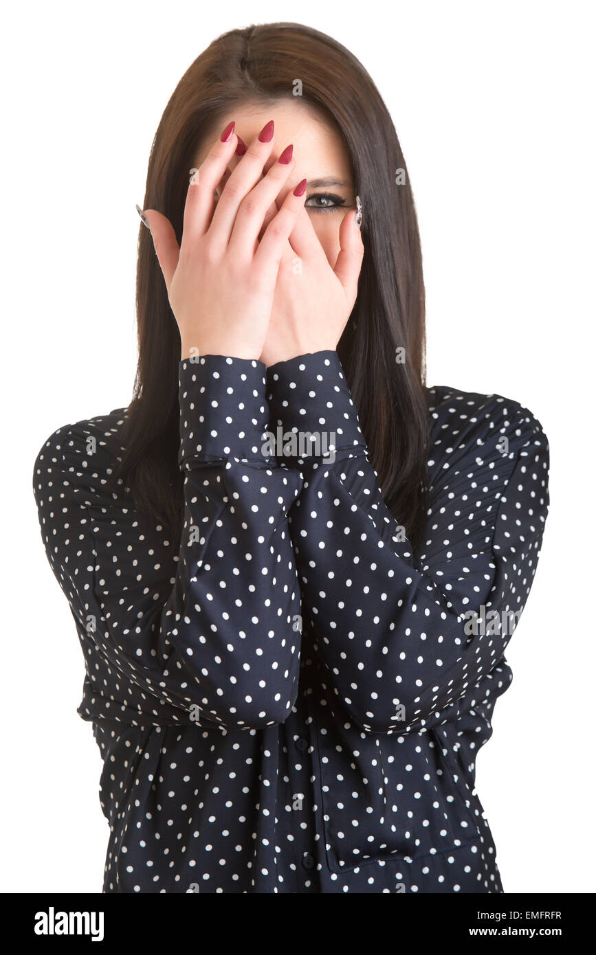 Shy girl covering up her face with her hands, isolated - Stock Image