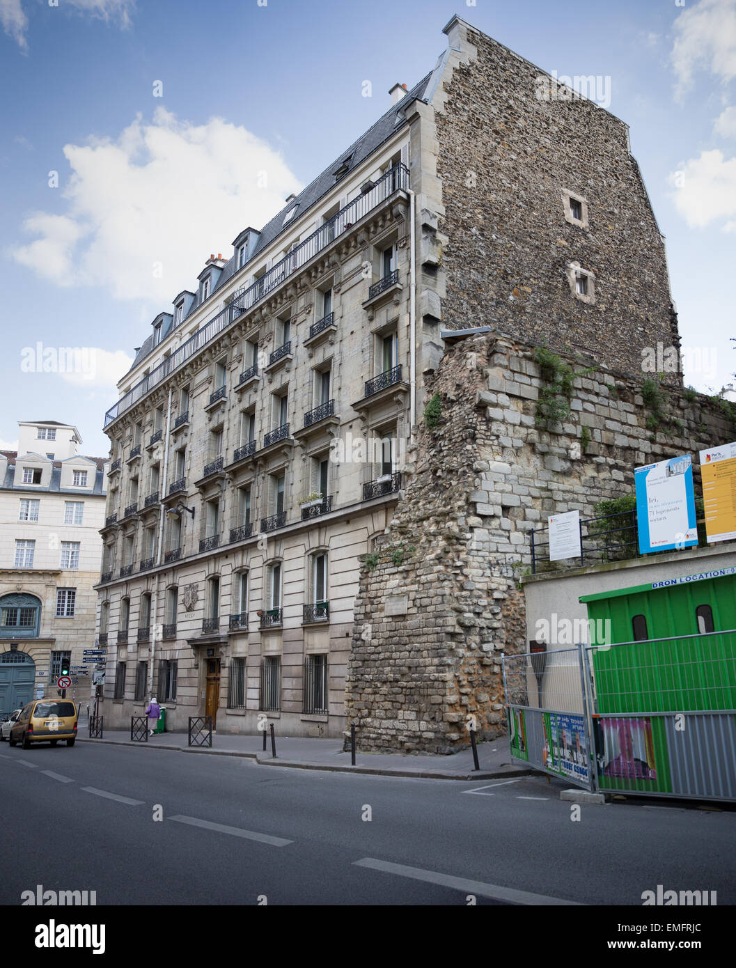 The Wall of Philip Augustus (1200-1215) next to an apartment building in the 5th arrondissement of Paris, France - Stock Image