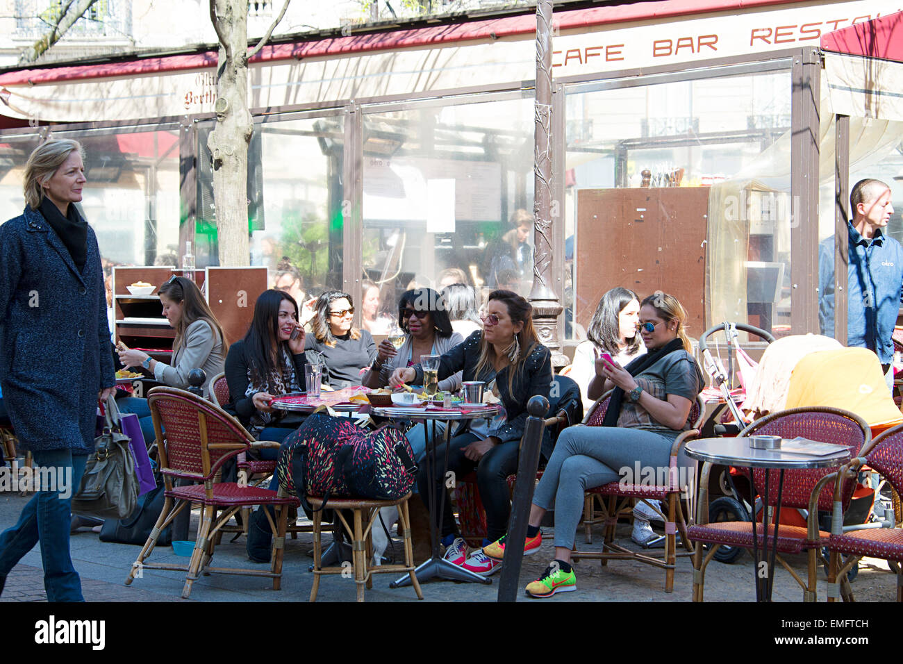 Paris young women enjoying relaxation time in city cafe. - Stock Image