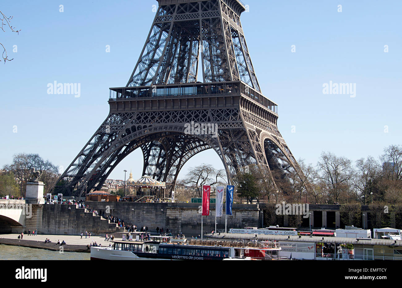 Paris Eiffel Tower attractions for visitors cruisers, motor launches, cruises, carousel - Stock Image