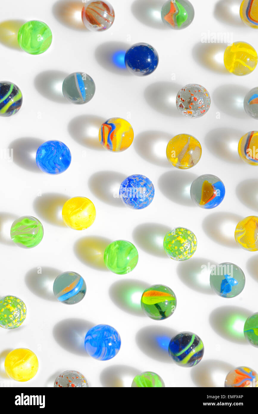 colorful glass marbles on white background - Stock Image
