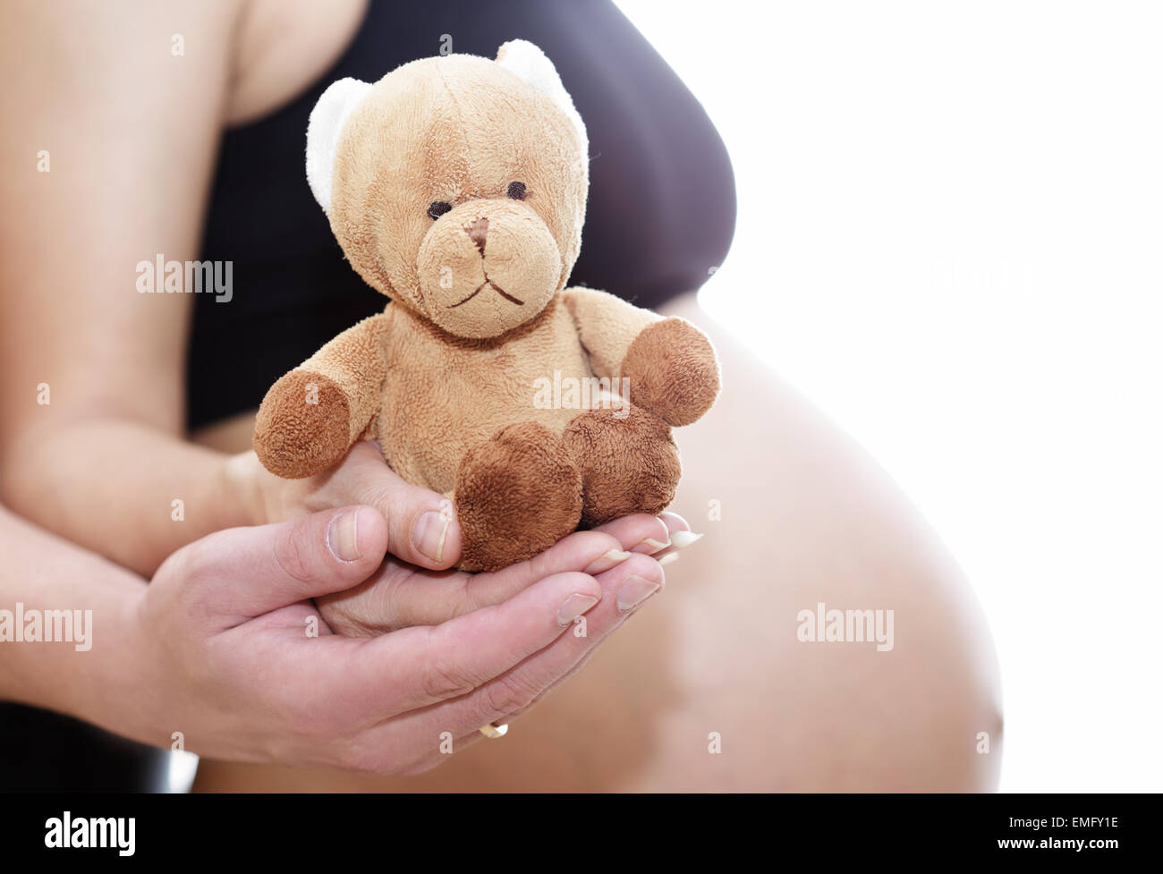 mom and dad prepare bear doll for a new life Stock Photo