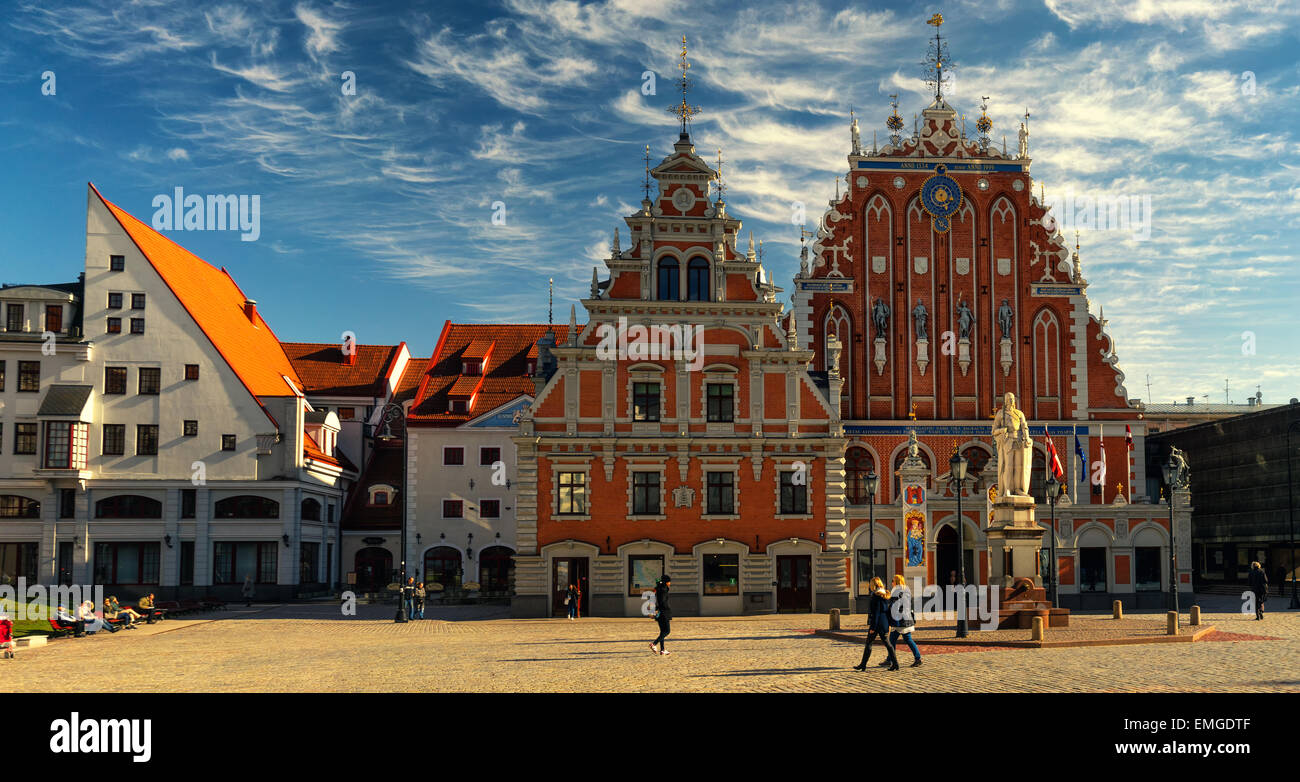 Tourists walk on the Town Hall Square in the House of Blackheads in Riga. Latvia - Stock Image
