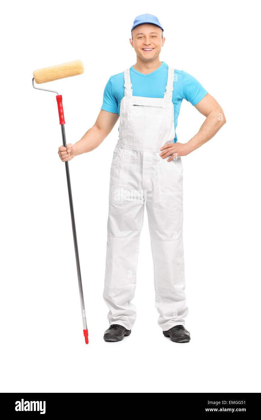Full length portrait of a male decorator posing with a paint roller isolated on white background - Stock Image