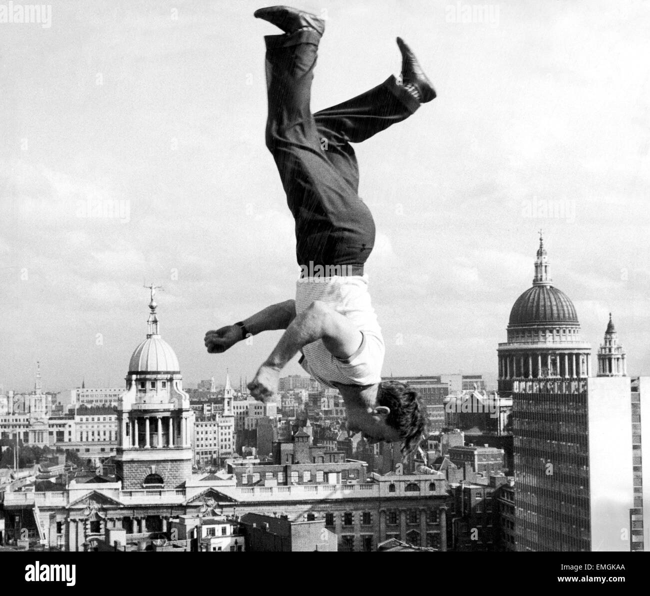 Acrobat Frank Paulo jumps upside down on a trampoline on the roof of the GPO building in London as he rehearses - Stock Image