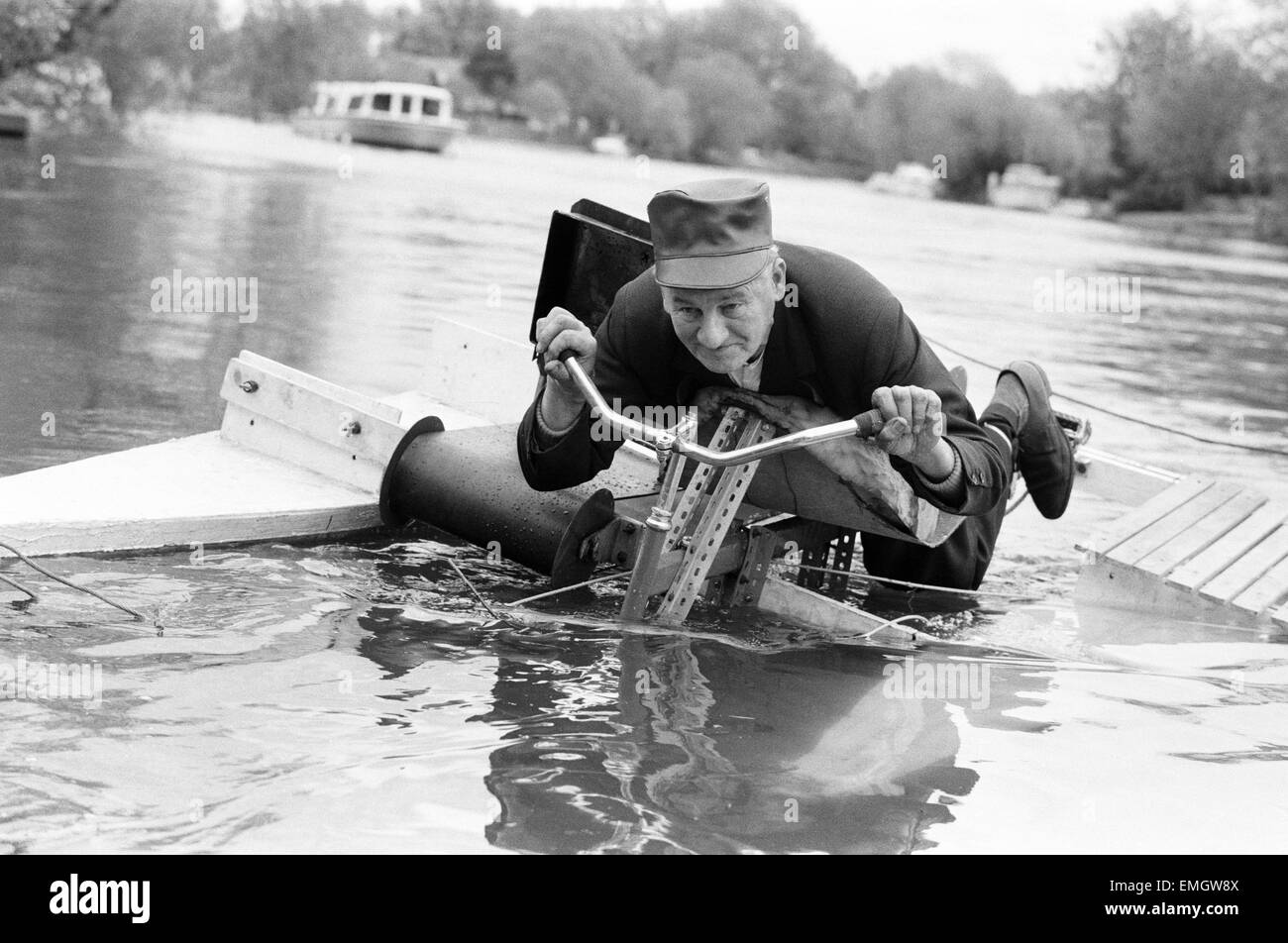 Pensioner Patrick Thomas pictured on his lying down bicycle equipped with floats as he makes his first voyage on - Stock Image