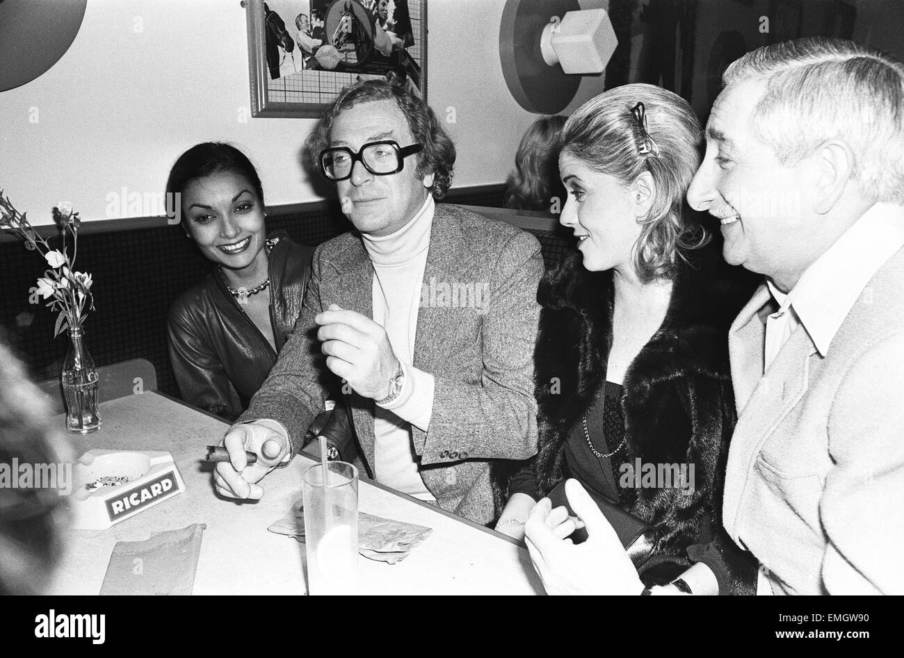 Actor Michael Caine with his wife Shakira photographed at boxer John Conteh's club in London. 16th December - Stock Image