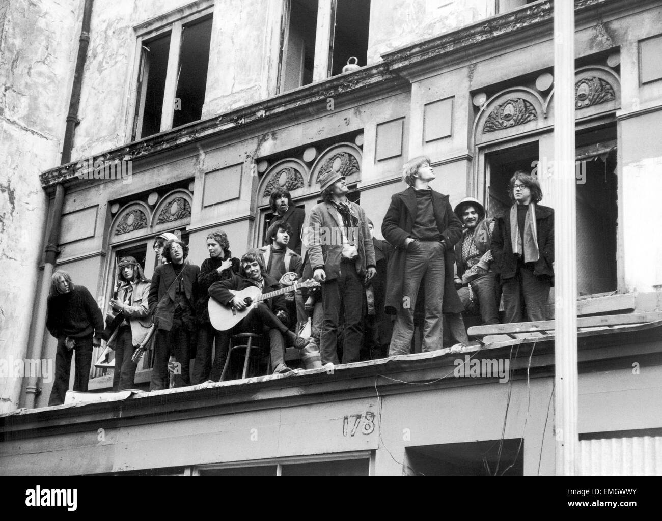 A group of 'Human Rights' sqautters singing We Shall Not Be Moved from the balcony of a derelict hotel they - Stock Image