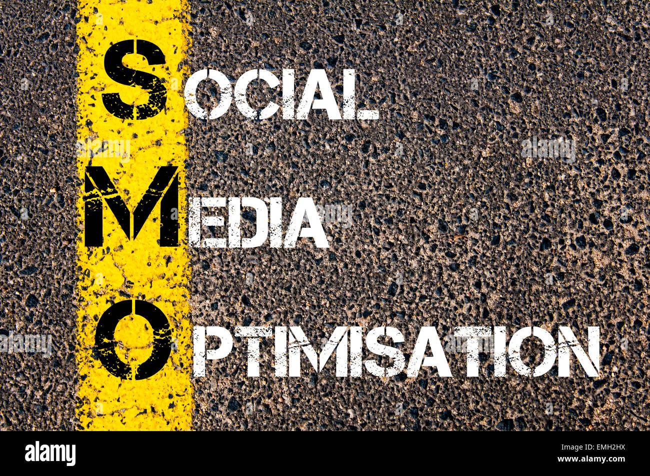 Social Media Acronym SMO as SOCIAL MEDIA OPTIMISATION. Yellow paint line on the road against asphalt background. - Stock Image