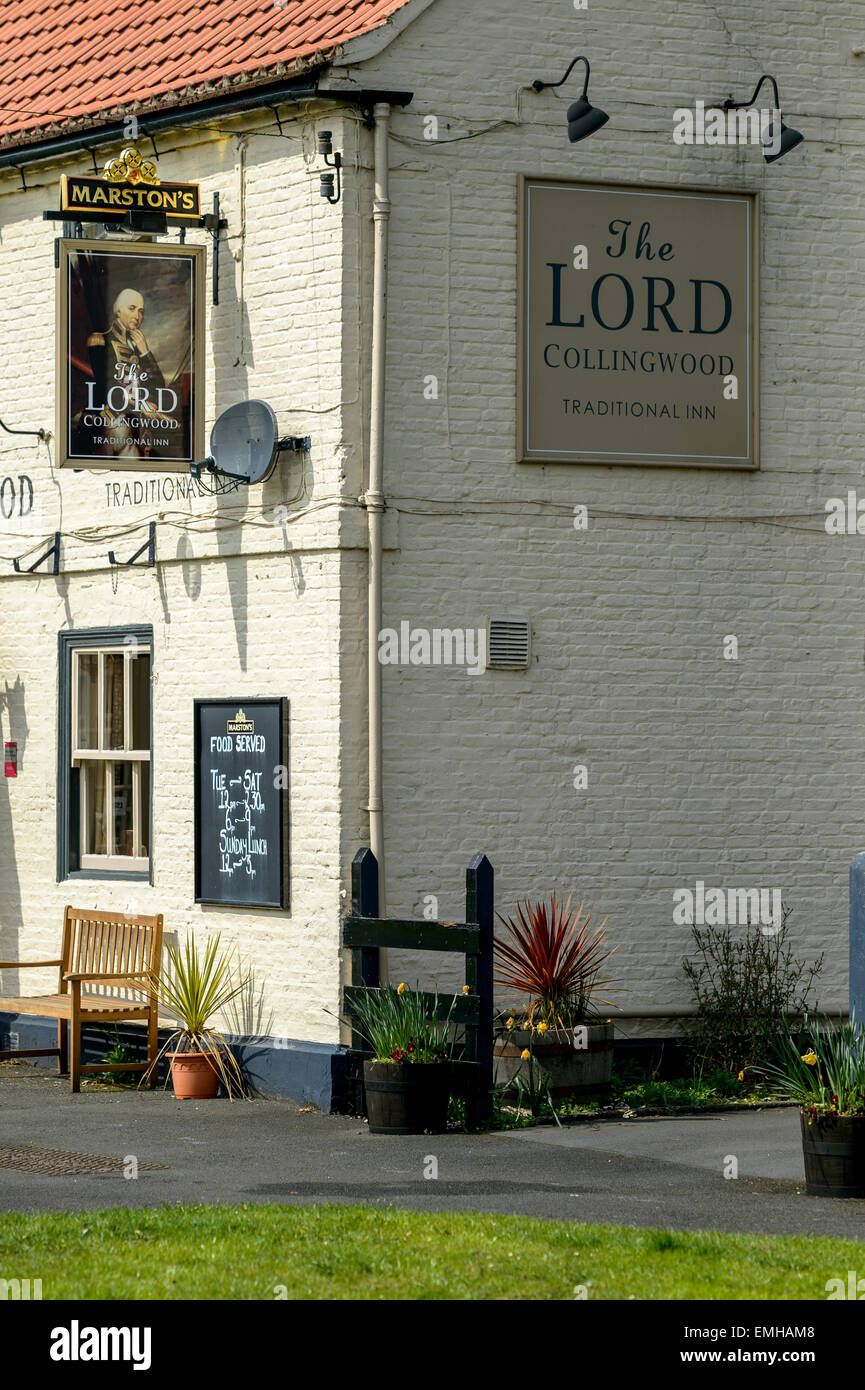 Namplates and hanging sign of the Lord Collingwood pub public house, a typically quaint village pub in rural Yorkshire. - Stock Image
