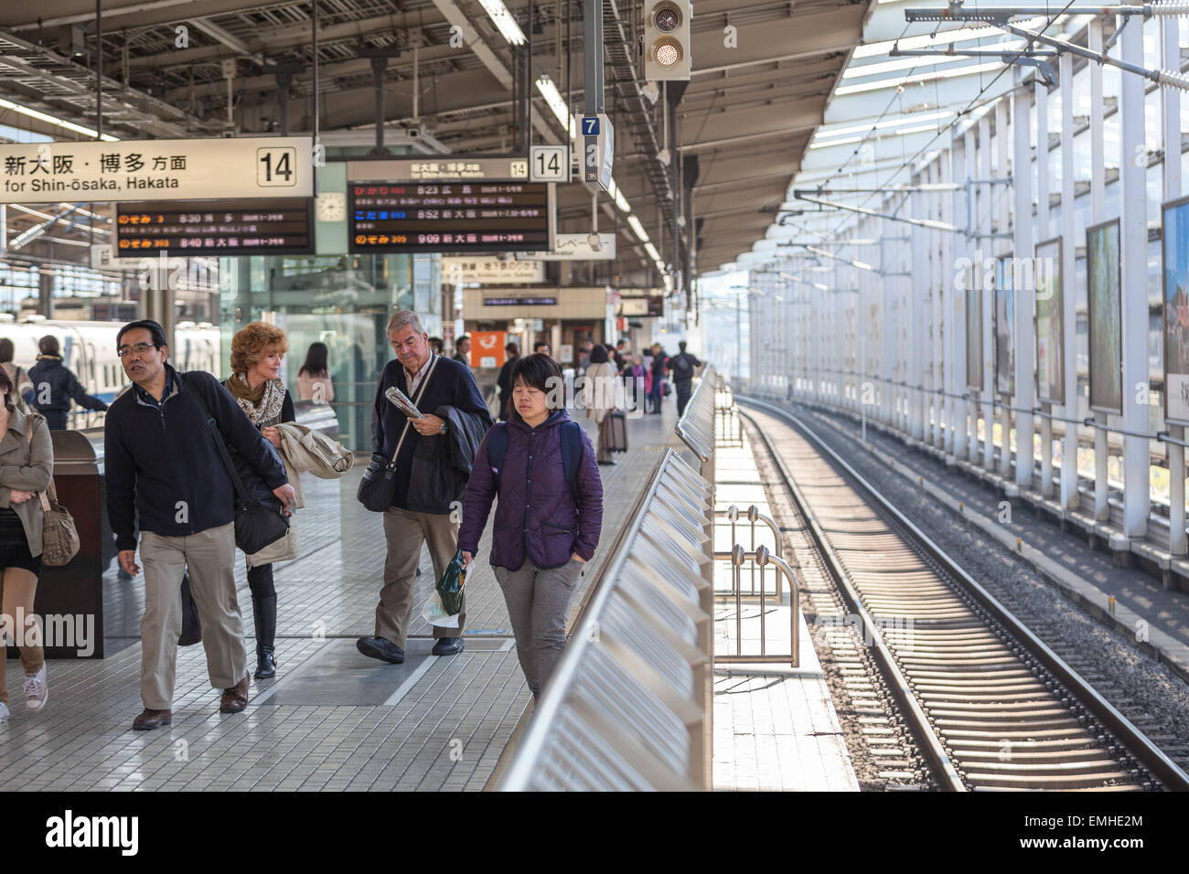 TOKYO, JAPAN - CIRCA APR, 2013: People walk on the Tokyo station platform. Empty railway. The Tokyo Station is a Stock Photo