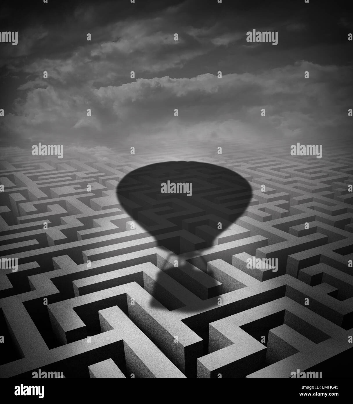 Overcome obstacles concept as a hot air balloon cast shadow on a maze or labyrinth as a motivational business metaphor - Stock Image