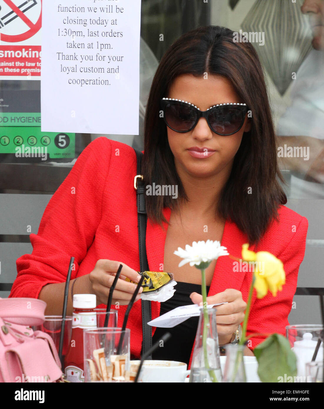 21 JULY 2013 ES LUCY MECKLENBURGH SEEN DRINKING TEA AND